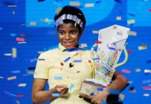 Zaila Avent Inernational Spelling Bee competition winner holding trophy.