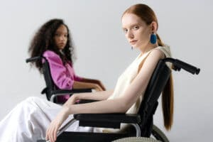 Women sittin in wheelchair looking at camera